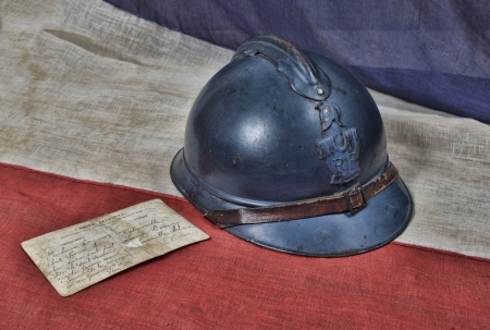 1914 french helmet with postcard of war