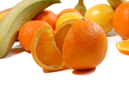 orange cut: orange cut into wedges with differents fruits