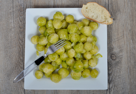 terroir: plate of brussels sprouts on the wood table Stock Photo