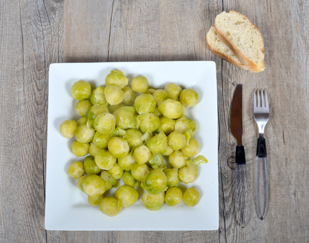 terroir: plate of brussels sprouts on the wood table with bread