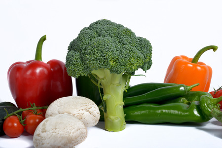 broccoli surround different seasonal vegetables isolated on a white background photo