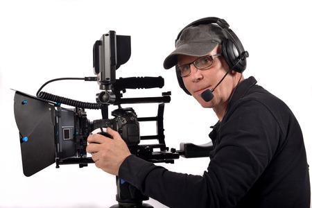 man with a camera on a tripod photo