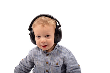 anti noise: baby with hearing protection on the head