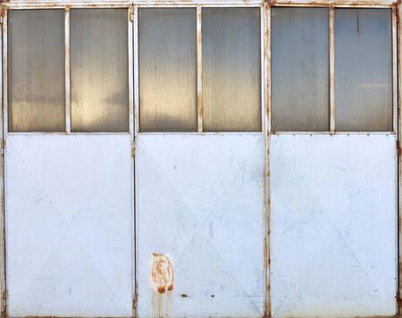 metal garage door painted blue with rust