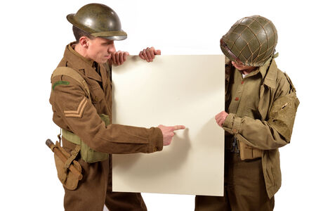 bristish and american soldier show a poster on the white background