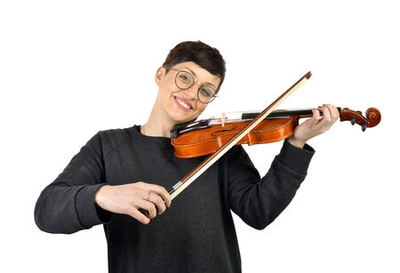 portrait of cheerful woman playing violin on white background photo