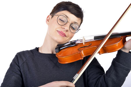 A young woman playing her violin with expression photo