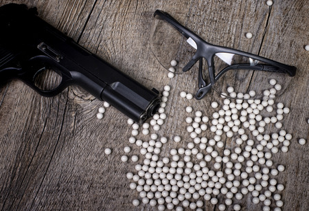 sidearm: airsoft gun with glasses and lot of bullets