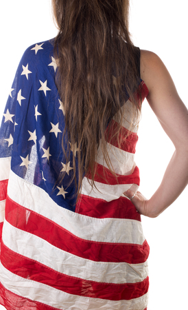 young woman from back and long hair dressed with an American flag photo