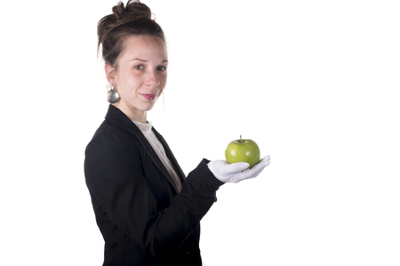 young woman holding an apple against white background