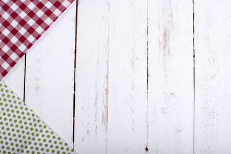 nostalgy: towels red and green table on a white wooden board