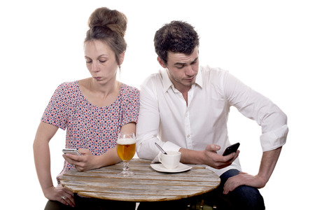 young couple with their phones are Disgruntled photo