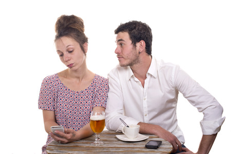 disgruntled: young couple with their phones are Disgruntled at  café terrace