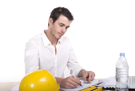 absorbed: Young architect absorbed in work and writing Stock Photo