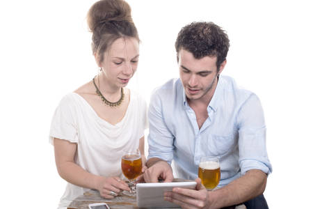 young couple playing with a digital tablet on a sun terrace photo