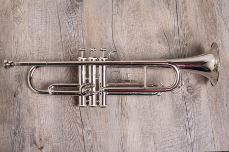 blare: trumpet on the wooden table