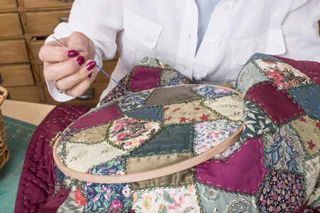 Mature woman by sewing and quilting in her home