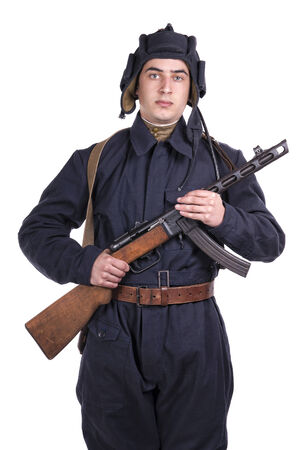 young Soviet tank driver with his gun on white background photo