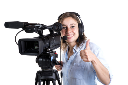 young woman with a video camera isolated on a white background Foto de archivo