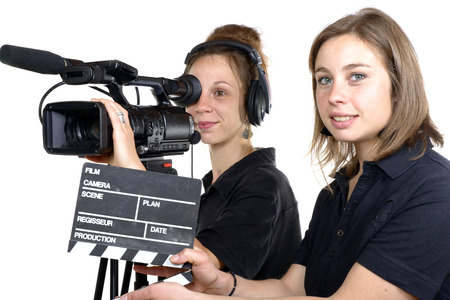 two young women with a video camera and a clapper board
