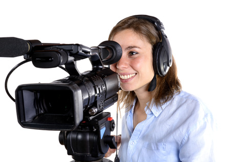 young woman with a video camera isolated on a white background photo