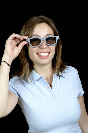 pretty woman with a pair of 3d glasses on black background photo