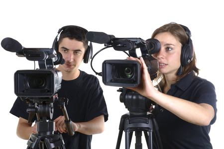 young man and young woman with video cameras on white background