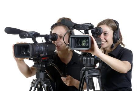 twee jonge vrouwen met een video camera op wit Stockfoto