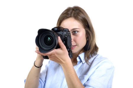 girl take a photo with digital camera on white background photo