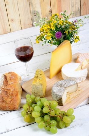 french cheese tray with seasonal fruits photo