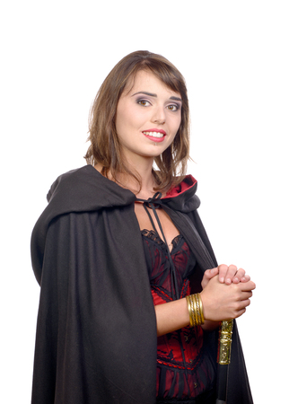 pretty girl dressed in a black cape for halloween photo