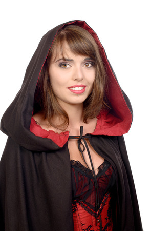 pretty girl dressed in a black cape for halloween on white background photo