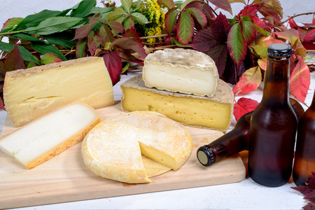 cheese platter: french cheese platter with bottles of beer