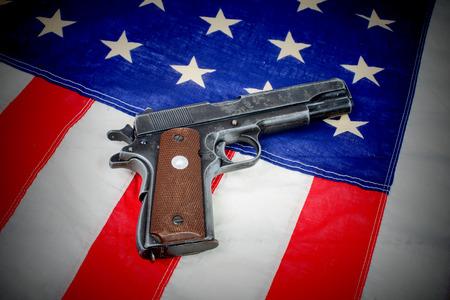hand gun: gun laid on the American flag close-up