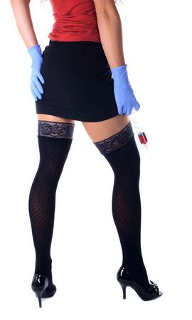 sexy nurse with a big syringe on the white background photo
