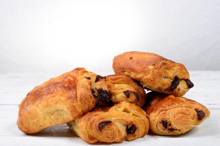 chocolate croissant on a white table photo