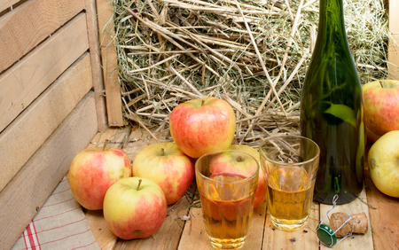 tagged: two glasses of cider with some apples