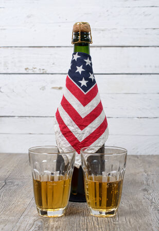 bottle of beer surrounded with an American flag photo