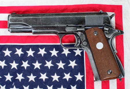 amendment: gun placed on an American flag