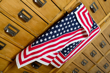 American flag out of the drawer of a cabinet photo