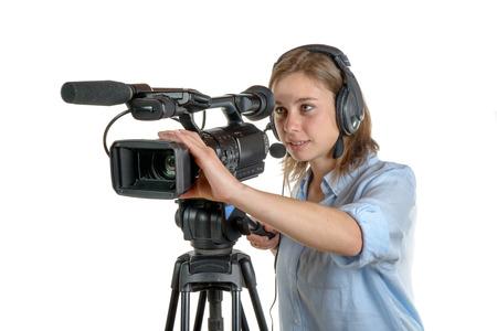 při pohledu na fotoaparát: mladá žena s kamerou a sluchátka Reklamní fotografie