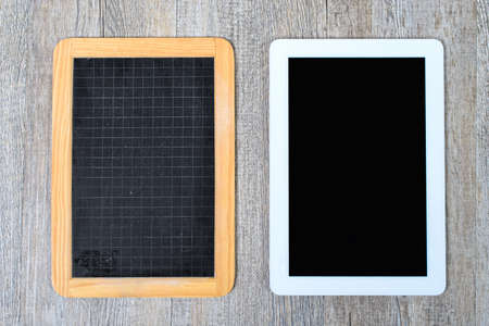 school blackboard and digital tablet on the wooden table photo