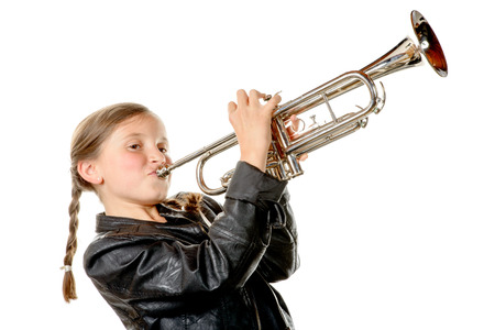 a pretty little girl with a black jacket plays the trumpet on the white background