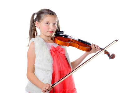 a pretty little girl playing the violin on the white background photo