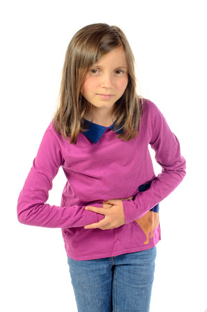 stomach ache: a girl has stomach ache on the white background