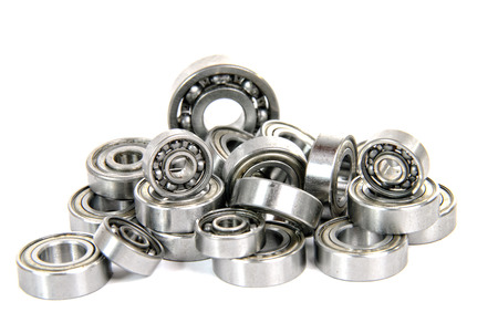 lot of small ball bearings on the white background