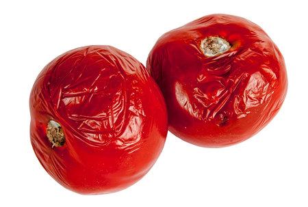 rotten tomatoes on the white background Foto de archivo