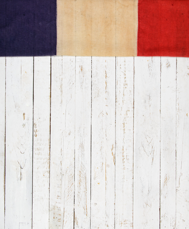 french symbol: English flag on a white painted wooden wall Stock Photo