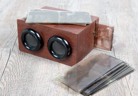 stereoscope: wooden stereoscope with glass plates on wooden table