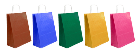 paper bags of different colors on the white background photo
